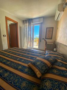 A bed or beds in a room at Hotel Amoha