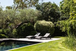 The swimming pool at or near Domaine Les Mésanges