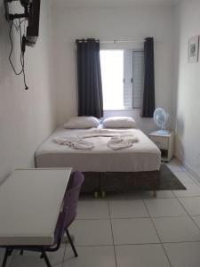 Cama ou camas em um quarto em Luman Hotel
