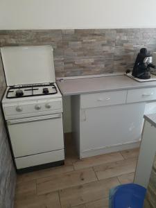 A kitchen or kitchenette at Napsugar Nyaraló