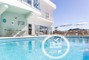 The swimming pool at or close to Casa do Outeiro - Arts & Crafts Boutique Hotel