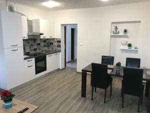 A kitchen or kitchenette at Apartments Lena