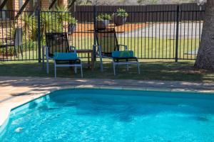 The swimming pool at or near Geraldton's Ocean West Holiday Units & Short Stay Accommodation