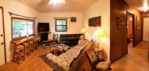 A seating area at Mountain Laurel Cottage at Hearthstone Cabins and Camping