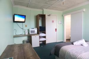 A television and/or entertainment centre at Warners Bay Hotel
