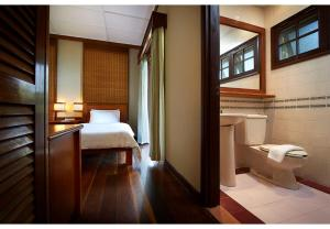 A bed or beds in a room at Redang Island Resort