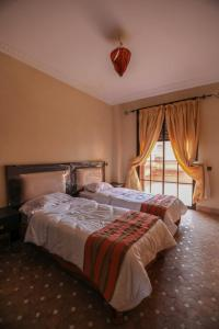 A bed or beds in a room at Top Garden Villa Marrakech