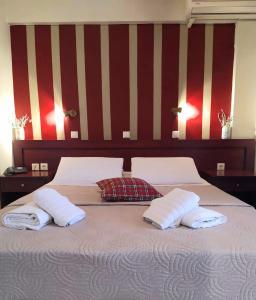 Кровать или кровати в номере Semiramis