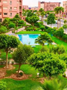 A view of the pool at Apartment with 2 bedrooms in Marrakech, with wonderful city view, shared pool, enclosed garden or nearby
