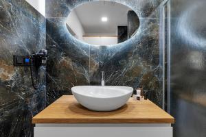 Koupelna v ubytování Nový designový apartmán s klimatizací