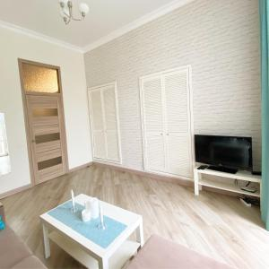 A television and/or entertainment center at Apartment Bunina 8