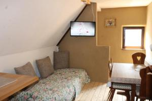 Cama ou camas em um quarto em Feriengut zum Trinkstorch