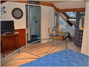 A television and/or entertainment centre at Captains Cabin