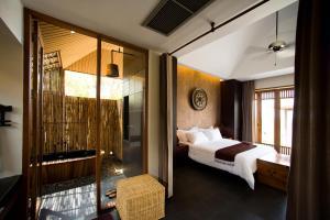A bathroom at GUTI Resort by AKA Hua Hin