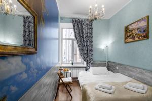 Кровать или кровати в номере Азарт