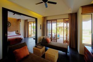 A seating area at GUTI Resort by AKA Hua Hin