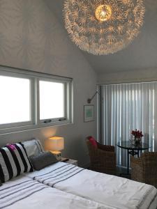 Un ou plusieurs lits dans un hébergement de l'établissement Studio Sunrise