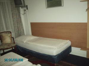 Ein Bett oder Betten in einem Zimmer der Unterkunft Hotel Garni Nord