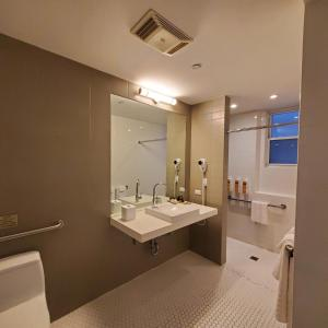 A bathroom at Best Western Plus Hospitality House Suites