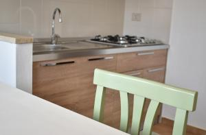 A kitchen or kitchenette at Hotel Residence Ampurias