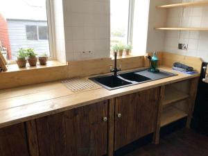 A kitchen or kitchenette at Water Front Beach House