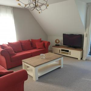 A seating area at Luxe kingsize appartement in Volendam