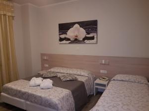 Letto o letti in una camera di Albergo Paradiso