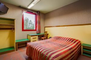 Cama o camas de una habitación en Hotel Siatel Chateaufarine