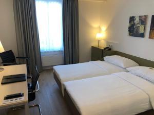 Ein Bett oder Betten in einem Zimmer der Unterkunft Hotel Schwanen Wil
