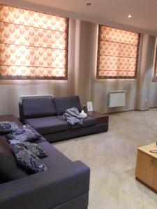 Uma área de estar em Mardakan Cottage House