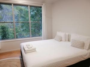 A bed or beds in a room at Stay @ LP Montville