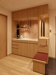 A kitchen or kitchenette at Saito Hotel