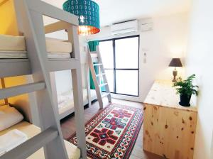 A bunk bed or bunk beds in a room at Ten to Sen Guesthouse