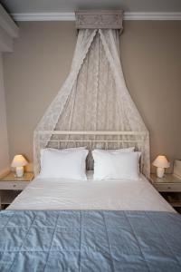 Ένα ή περισσότερα κρεβάτια σε δωμάτιο στο Saga Hotel