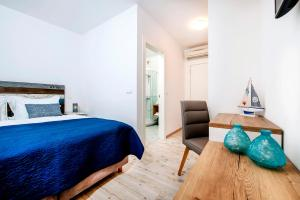 A bed or beds in a room at Villa Marea