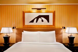 A bed or beds in a room at The Ritz-Carlton, Bahrain