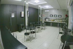 A restaurant or other place to eat at Grande Hotel
