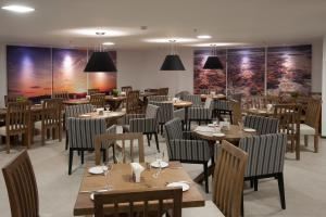 A restaurant or other place to eat at Ritz Suites Home Service