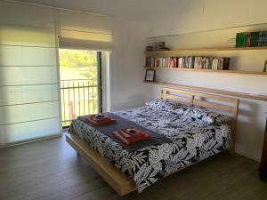 Letto o letti in una camera di Cottage del fiume