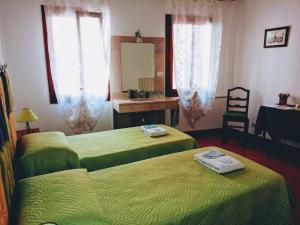 Cama ou camas em um quarto em Casa Favaretto Guest House