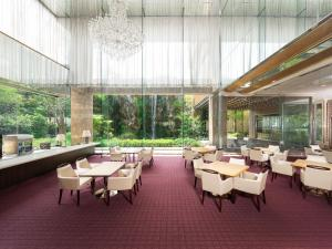 A restaurant or other place to eat at Nara Royal Hotel