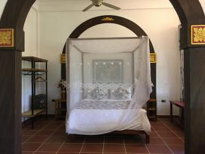 A bed or beds in a room at Phong Nha Farmstay