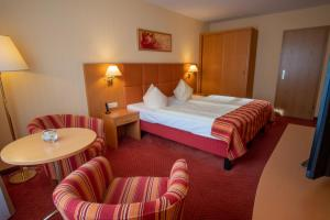 A bed or beds in a room at Centralhotel Binz