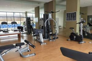 The fitness centre and/or fitness facilities at Azalea Suites Cikarang - By Urban Style Collections
