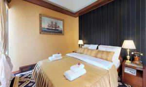 A bed or beds in a room at Historic Boutique Hotel Cattaro