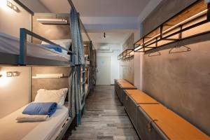 A bunk bed or bunk beds in a room at Bedbox Hostel