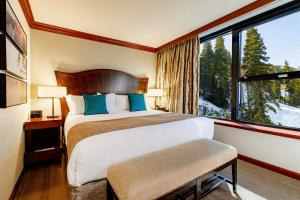 A bed or beds in a room at Resort at Squaw Creek, a Destination by Hyatt Residence