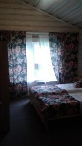 Кровать или кровати в номере Гостевой двор Starspodvorie