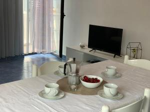 A television and/or entertainment centre at Apartments Ema