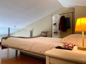 Cama o camas de una habitación en Apartaments Turístics Cal Patoi